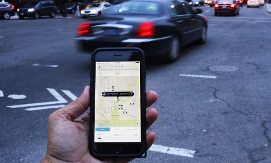 A mobile phone with the Uber app