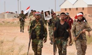 Syrian forces raise their flag in northern Syria