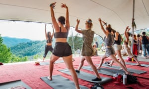 People do yoga at Meadows in the Mountains festival