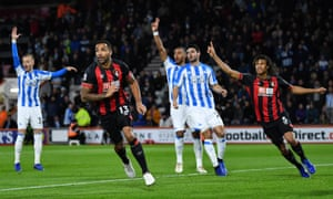 Bournemouth's Callum Wilson wheels away in celebration after opening the scoring whilst the Huddersfield players appeal for offside.