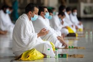 Pilgrims praying at the Masjidil Haram, Islam's holiest site, during the Tawaf Al-Qudum (Tawaf of Arrival) on the first day of Hajj 2020, in Mecca, Saudi Arabia.