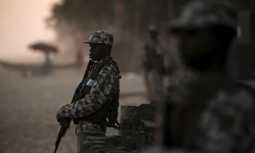 Soldiers stand guard on the beach after the terrorist attack in Grand Bassam, Ivory Coast