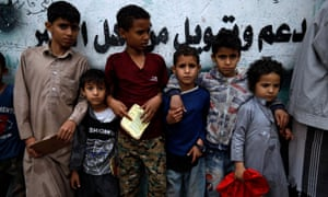 Yemeni children wait to get food rations from a charity group in Sana'a, Yemen, on 4 May 2020. According to reports, nearly 80 percent of Yemen's 27 million-population rely on humanitarian aid.