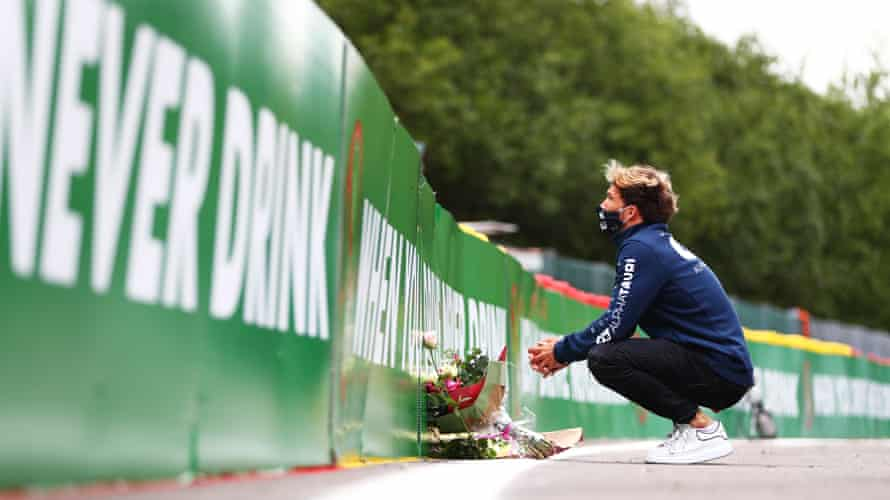 Pierre Gasly leaves flowers at the side of the track at at Spa-Francorchamps in memory of the late Formula 2 driver Anthoine Hubert