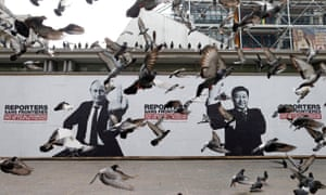 """Pigeons fly past a poster depicting Russian President Putin and his Chinese counterpart Xi pasted on the Brancusi Atelier by activists from Reporters Without Borders (RSF) to mark the 20th annual World Press Freedom day in Paris<br>Pigeons fly past a poster depicting Russian President Vladimir Putin and his Chinese counterpart Xi Jinping (R) pasted on the Brancusi Atelier by activists from Reporters Without Borders (RSF) to mark the 20th annual World Press Freedom day in Paris, May 3, 2013. The slogan reads, """"Without freedom of information, no counter-power"""". REUTERS/Benoit Tessier (FRANCE - Tags: POLITICS CIVIL UNREST MEDIA ANIMALS TPX IMAGES OF THE DAY) TEMPLATE OUT"""