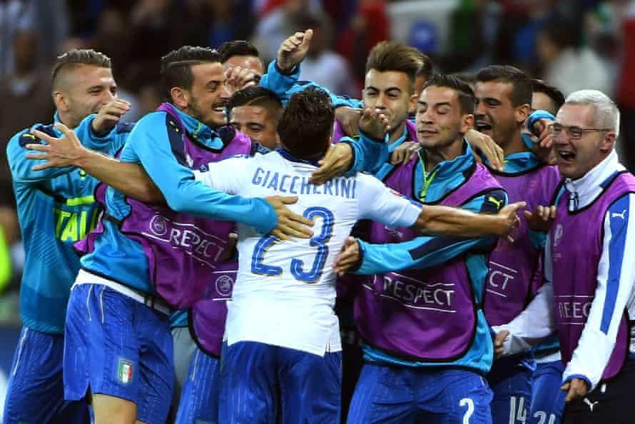 Italy's Emanuele Giaccherini celebrates with his squad after scoring.