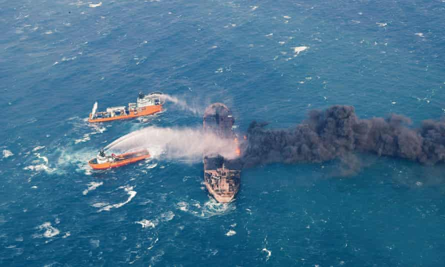 Firefighting boats work to put on the blaze on the oil tanker Sanchi