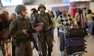 Soldiers patrol at Rio de Janeiro international airport as athletes and visitors arrive ahead of the 2016 Olympics. Police said the investigation began in February.