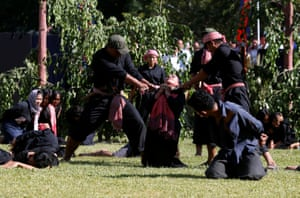 Actors attending an annual Day of Anger in Phnom Penh, Cambodia, recreate a killing in memory of those who perished during the communist Khmer Rouge regime