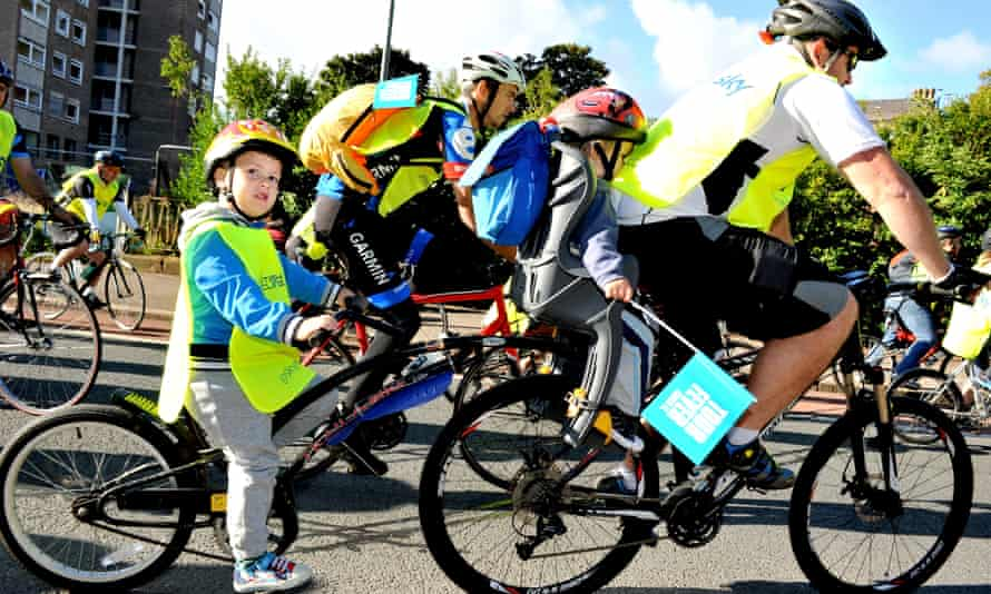 Cyclists participate in the Sky Ride bike event in Liverpool, England.