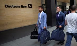 Tailors from Fielding & Nicholson leave Deutsche Bank's City office on Monday