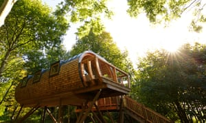 Touch wood … a glamping treehouses in Wales