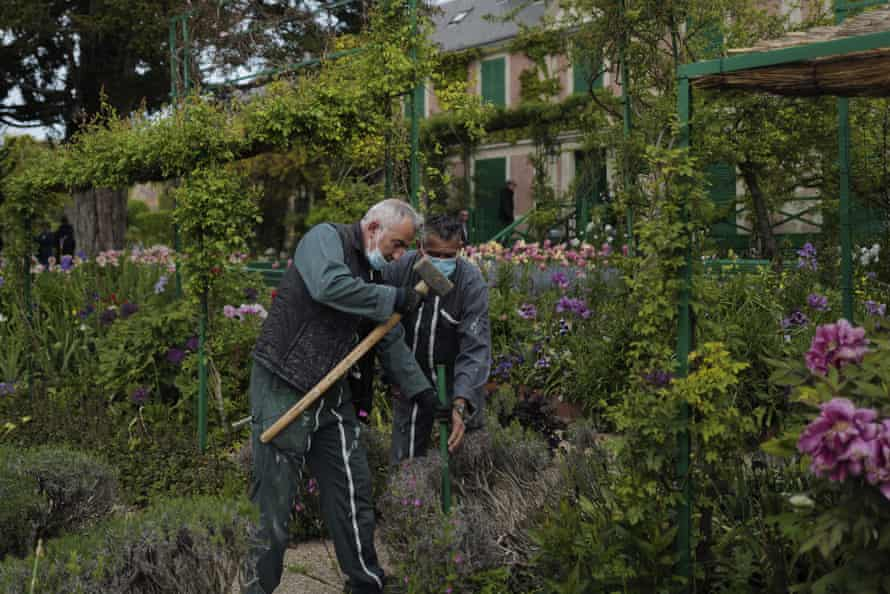 Gardeners work in the Japanese-inspired water garden.