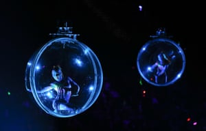 Acrobats in New York perform in transparent balls suspended from the rafters
