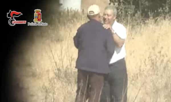 An undated image provided by the Italian police shows a police surveillance photo of a meeting between Vito Gondola, left, 77, and Michele Gucciardi, 62, near Sicily. Eleven members of the Sicilian mafia have been arrested by Italian police.