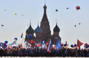 Moscow, Russia. Trade union members hold balloons, flags and flowers for their parade on Red Square during a May Day demonstration
