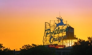 Sunset over the iconic Portland, Oregon Old Town sign in downtown Portland, Oregon.