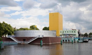 The Groninger Museum in the Netherlands. Mendini designed the entrance, marked by a golden windowless tower, and invited the French designer Philippe Starck and fellow Italian Michele de Lucchi to take on their own sections.