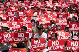 Protesters hold placards and shout slogans during the Sunday's rally in Hong Kong