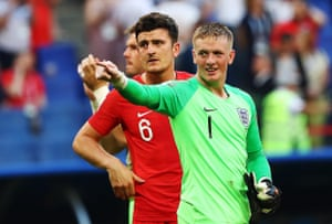 England's Harry Maguire and goalkeeper Jordan Pickford celebrate their victory.