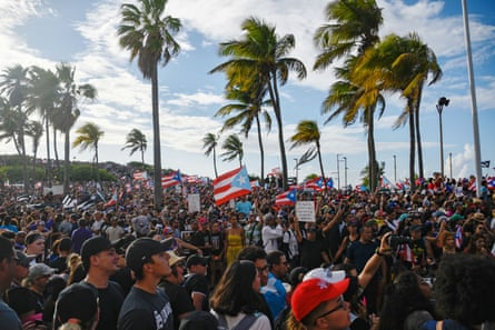 Demonstrators chant and wave Puerto Rican flags in San Juan.