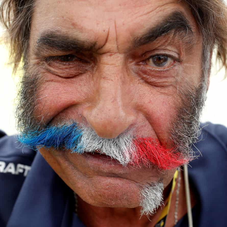 A French TV motorbiker with his moustache dyed in the colours of the French flag.