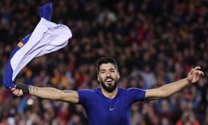 Luis Suárez waves with his shirt as he celebrates scoring Barcelona's first goal against Atlético Madrid at the Camp Nou.
