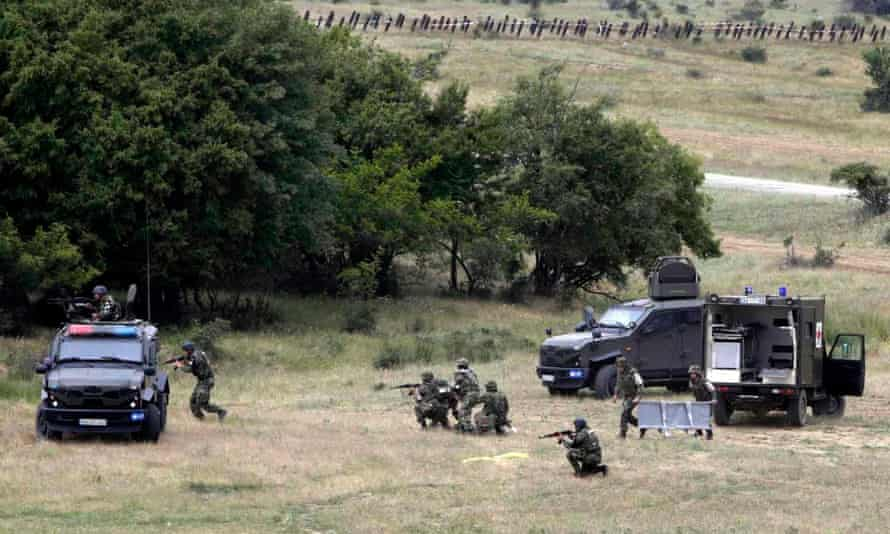 Bulgarian troops take part in a military exercise with their US counterparts near the eastern town of Mokren