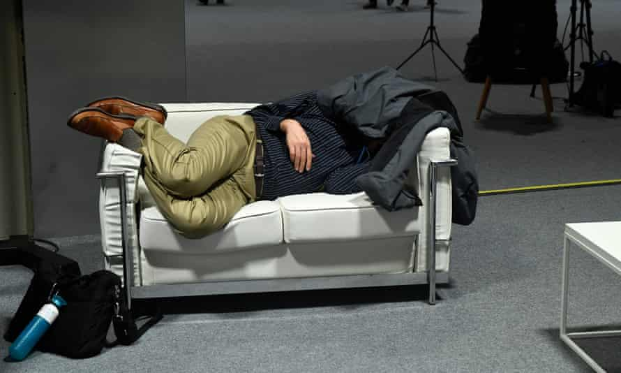 A delegate gets some sleep at COP25 in Madrid.