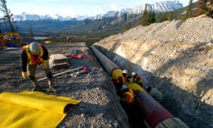 Workers construct the anchor loop section of Kinder Morgan's Trans Canada pipeline in Jasper national park in 2009.