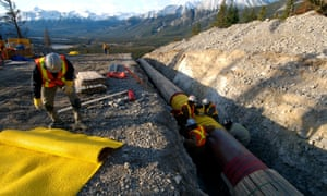 Workers construct the Anchor Loop section of Kinder Morgan's Trans Mountain pipeline expansion in Jasper national park in a 2009 file photo