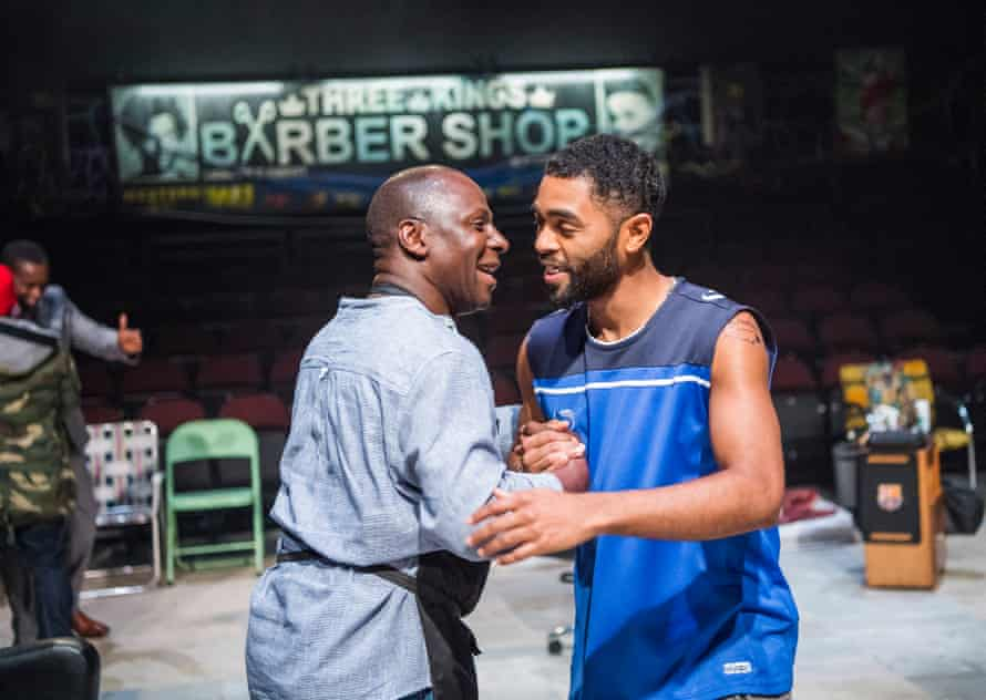 Cyril Nri and Anthony Welsh in Barber Shop Chronicles at the National Theatre in 2017.