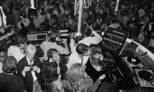 Mixing decks and a packed dance floor at a party at Studio 54 in 1978.