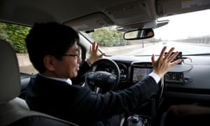 Nissan's head of automated driving, Tetsuya Lijima, sits at the controls of a modified Nissan Leaf during its first demonstration on public roads in Europe, in London. c
