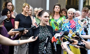 Rebecca Jancauskas (centre) speaking on behalf of victims outside court in Sydney in 2019.