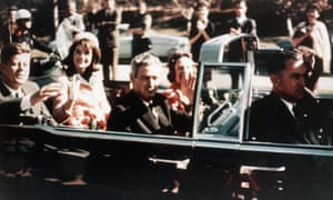 President John F Kennedy, First Lady Jacqueline Kennedy, and the Texas governor, John Connally, ride through the streets of Dallas.