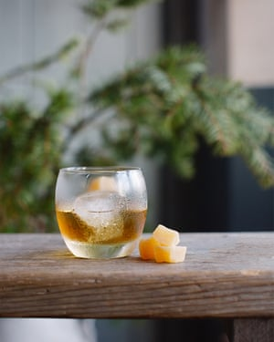 A cocktail with fruit
