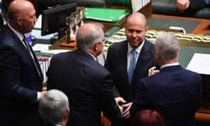 Treasurer Josh Frydenberg is congratulated by prime minister Scott Morrison after delivering the 2021-22 budget in the House of Representatives at Parliament House in Canberra