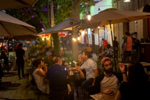 People sit in bar terraces in downtown Santiago, on 23 December, 2020