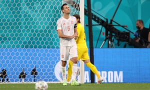 Sergio Busquets of Spain reacts after missing their first penalty.