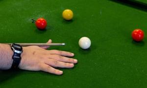John playing pool