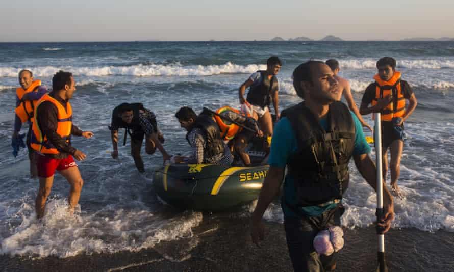 Migrants from Pakistan arrive on the Greek island of Kos