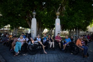 Older people in Ponce outside their nursing home, which was evacuated