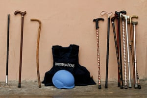 The walking sticks commonly carried by Somali elders and the protective gear worn by the United Nations staff