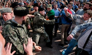 Cossacks scuffle with opposition supporters during an anti-Putin rally in Moscow on 5 May