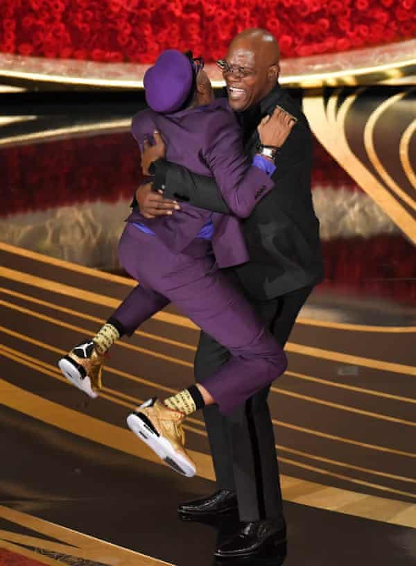 Spike Lee jumps into Samuel L Jackson's arms at the 91st Academy Awards.