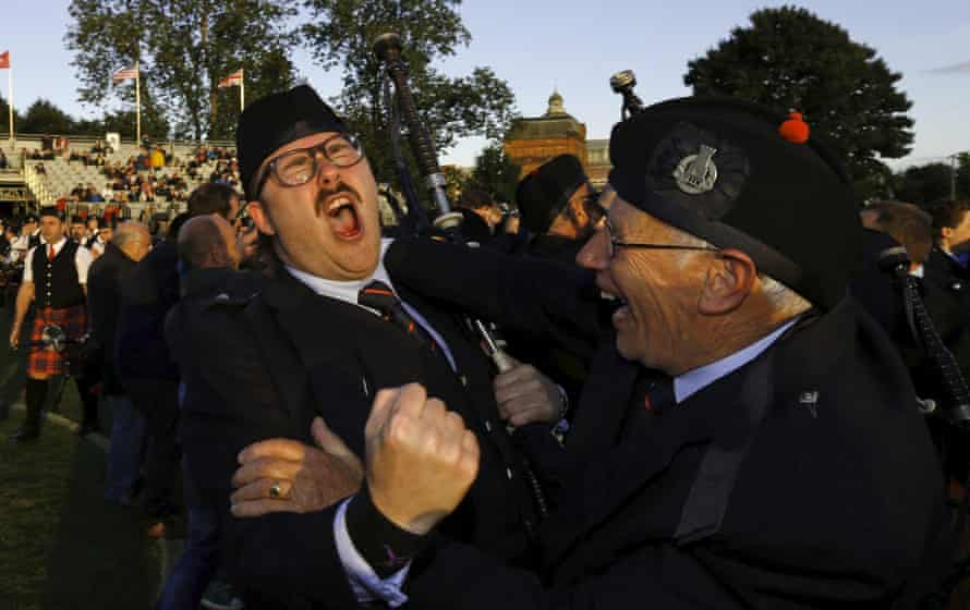 Members of the Shotts and Dykehead Caledonia react to winning the annual World Pipe Band Championships in Glasgow.