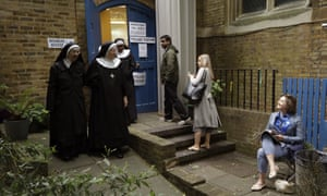 Benedictine nuns from Tyburn Convent leave after voting in Britain's general election at a polling station in St John's Parish Hall, London
