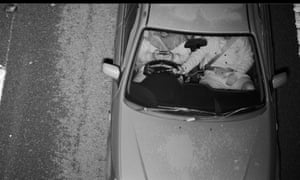 Driver on mobile phone while passenger hold the steering wheel