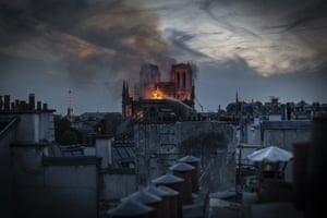 Flames and smoke are seen billowing from the roof at Notre-Dame Cathedral